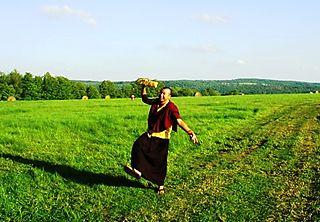 Palyul Retreat -- Lama Rabgye Dancing in Field -- WS