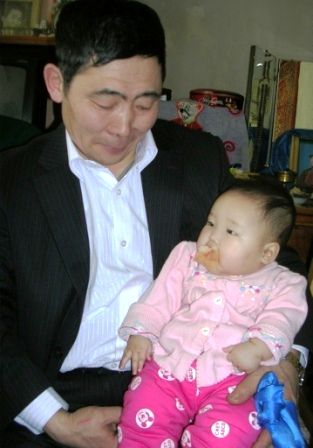 Mongolia -- Tsagaan Sar 2009 -- Man and Baby -- WS