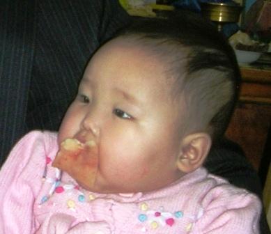 Mongolia -- Tsagaan Sar 2009 -- Baby with Fat Pacifier -- WS