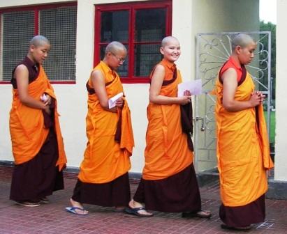 India 2009 -- Namdroling -- Mongolian Nun Smiling in Line -- WS