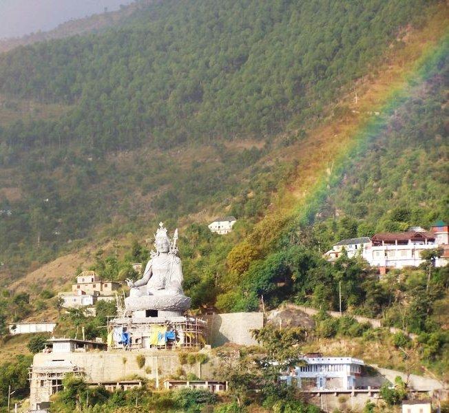 Guru_rinpoche_and_rainbows_close