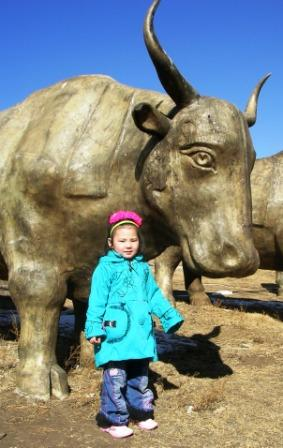 Ub_little_girl_and_bull_ws