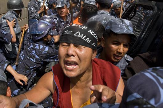 Tibetan_monk_and_police_nepal