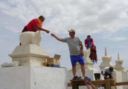 Dornogov_shambhala_stupa_filling_handing